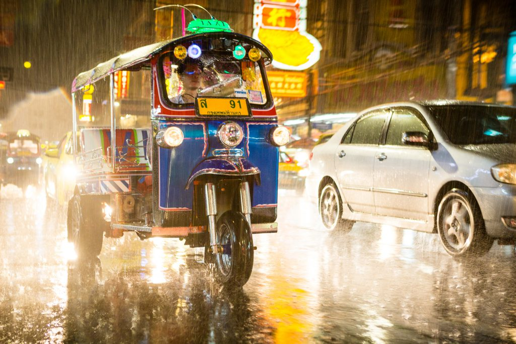 A tuk-tuk during a tropical rainstorm, Bangkok, Thailand